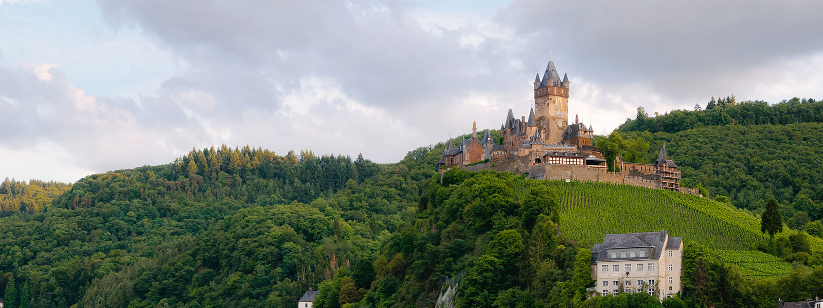 German castle towering over lush green hill