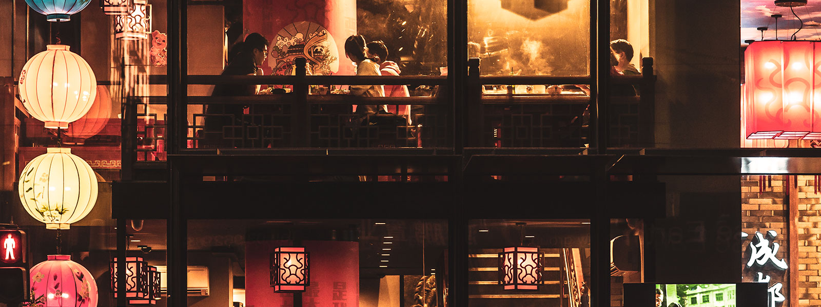 Dimly-lit restaurant in Hong Kong where friends are dining