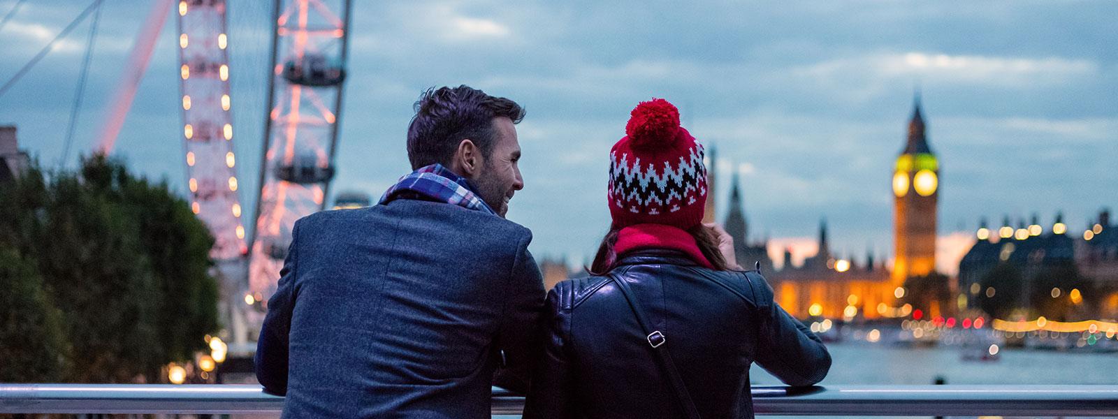 Couple looking over London landmarks